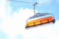 Cableway orange seat of hanging on iron rope Royalty Free Stock Images