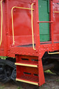 Caboose detail a red or end car of a train showing the steps to the rear platform and the entry door Royalty Free Stock Photography