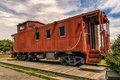 Caboose an old red in a city park Royalty Free Stock Photo