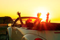 Cabriolet sunset happy family in a convertible car at the in summer Royalty Free Stock Photos