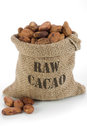 Cacao beans in burlap bag Stock Photo