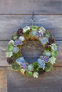 Cactus wreath colorful weath hanging on rustic wooden wall Stock Photo