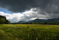 Cades cove stormy distant mountains meadow Royalty Free Stock Photo