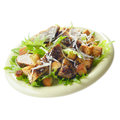 Caesar chicken salad on white background with grated parmesan Stock Photo
