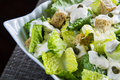 Caesar salad close up with grated parmesan croutons and dressing Royalty Free Stock Photo