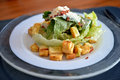 Caesar salad close up in white plate Stock Photos