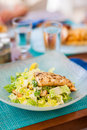 Caesar salad delicious fresh with grilled fish served for lunch at restaurant Stock Image