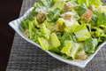 Caesar salad detail with grated parmesan and croutons Royalty Free Stock Image