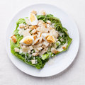 Caesar salad with eggs and chicken breast Royalty Free Stock Images