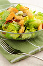 Caesar salad fresh with croutons and bacon bits served in a glass bowl Stock Image