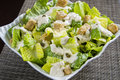 Caesar salad with grated parmesan croutons and dressing Royalty Free Stock Image
