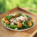 Caesar salad with grilled chicken Stock Photos