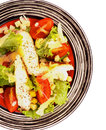 Caesar salad with grilled chicken breast garlic crouton lettuce tomatoes and grated parmesan cheese closeup on striped plate top Royalty Free Stock Photography
