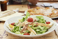 Caesar salad with grilled chicken, ham, eggs and tomatoes Royalty Free Stock Photo