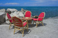 Cafe on the beach table and chairs shore of adriatic sea Royalty Free Stock Photo