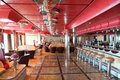 Cafe with bright interior, bar and red celling Royalty Free Stock Photo