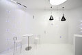 Cafe interior in minimalist style with white walls and black and white bulbs Stock Photos