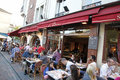 Cafe montmartre paris france has sidewalk setup with tables in Stock Images