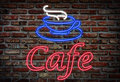 Cafe neon sign on brick background Royalty Free Stock Image