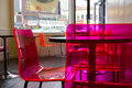 Cafe with pinc acrylic chairs Royalty Free Stock Photo
