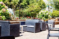 Cafe with rattan wicker armchairs and tables on the summer garde Royalty Free Stock Photo
