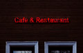 Cafe Restaurant Neon sing on wood Royalty Free Stock Photo