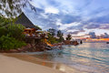 Cafe on Seychelles tropical beach at sunset Royalty Free Stock Photo