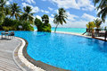 Cafe and swimming pool on the tropical beach Royalty Free Stock Photography