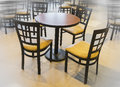 Cafe table and chairs, a calm place to meet and rest amidst hurr