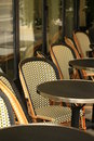 Cafe tables chairs paris france Royalty Free Stock Photos