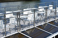 Cafe tables on deck of pleasure boat