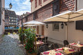 Cafe tables in petite france in strasbourg france alsace Stock Images