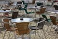 Cafe tables with wicker furniture Royalty Free Stock Photo
