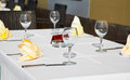 Cafe terrace with dinner table place setting napkin wineglass Royalty Free Stock Photos