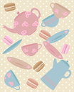 Cafe vintage an illustration of elements from a including teapot cup saucer coffee pot and macaroons in colors with a polka dot Royalty Free Stock Photo