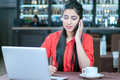 Cafe young indian businesswoman on a coffee break using tablet computer Stock Photography