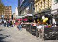Cafes leicester square london england people enjoy the outdoor in on a beautiful day in great britain Stock Images