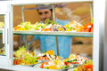 Cafeteria food display young man choose salad Stock Photography