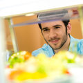 Cafeteria food display young man choose salad Royalty Free Stock Photography
