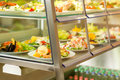 Cafeteria self service display food fresh salad Royalty Free Stock Photo