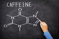 Caffeine chemical molecule structure on blackboard drawing chalkboard as it is found in coffee and tea etc Stock Photos