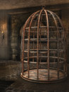 Cage in a dungeon old rusty Stock Photo