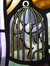 Caged doves macro stained glass segment of two white in a cage Stock Image