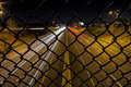 Caged highway long exposure photo of a from a cage enclosed overpass above at night Stock Photo