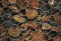 Caged stones wire order pattern background shapes behind the wire Stock Photography