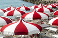 Cagnes sur mer cote d azur alpes maritimes provence alpes france red and white umbrellas on the beach Royalty Free Stock Images