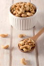 Cahew nuts in the ladle selective focus on cashewnuts wooden Royalty Free Stock Image