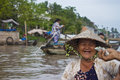 Cai rang floating market can tho vietnam july unidentified woman seller at a boat at in can tho vietnam on july is Stock Image