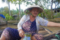 Cai rang floating market can tho vietnam july unidentified woman vendor at a boat at in can tho vietnam on july is Stock Photos