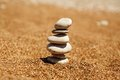 Cairn on the sand pile from stones beach near sea harmony and stability concept Stock Photography